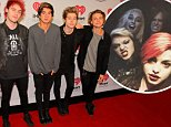 BOSTON, MA - DECEMBER 14:  (L-R) Michael Clifford, Calum Hood, Luke Hemmings and Ashton Irwin of 5 Seconds of Summer attend Kiss 108's Jingle Ball 2014 at TD Garden on December 14, 2014 in Boston, Massachusetts.  (Photo by Mike Lawrie/WireImage)