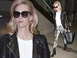 """""""Mad Men"""" actress, January Jones fly's into LAX carrying her iPhone while wearing a leather jacekt, black & white patterned pants & pink highlights in her blonde hair.   Pictured: January Jones Ref: SPL983142  230315   Picture by: Splash News  Splash News and Pictures Los Angeles: 310-821-2666 New York: 212-619-2666 London: 870-934-2666 photodesk@splashnews.com"""