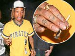 Wiz Khalifa lights up a funny looking, hand-rolled cigarette on the streets of Hollywood as he arrives at Project Club to support Mike B's party. March 23, 2015 X17online.com