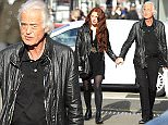 March 24th, 2015 - London *** EXCLUSIVE ALL AROUND PICTURES *** Rock legend Jimmy Page enjoying the spring sunshine with with his beautiful redheaded girlfriend in West London. The couple enjoyed an intimate lunch, finished of with a trip to a iconic book store, both browsed the art book section together and appeared ecstatically happy in each other company . ****** BYLINE MUST READ :    Spread Pictures ****** ****** No Web Usage before agreement ****** ****** Strictly No Mobile Phone Application or Apps use without our Prior Agreement ****** Enquiries at photo@spreadpictures.com
