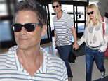 Rob Lowe holds hands with his wife Sheryl Berkoff as they arrive at Los Angeles International Airport (LAX)\nFeaturing: Rob Lowe, Sheryl Berkoff\nWhere: Los Angeles, California, United States\nWhen: 24 Mar 2015\nCredit: MONEY$HOT/WENN.com