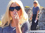 Lady Gaga dressed in understated wide legs and a striped shirt,   scouting the Exclusive Broad Beach Club in Malibu  for a possible Wedding location perhaps with all the stress she needed a cigarette//// and showing off her engagement ring.   March 24, 2015 Juliano/X17online.com\nNO WEB SITE USAGE\nMAGAZINES DOUBLE FEES\nAny queries call X17 UK Office /0034 966 713 949/926 \nAlasdair 0034 630576519 \nGary 0034 686421720\nLynne 0034 611100011