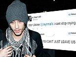 Mandatory Credit: Photo by Broadimage/REX (4270887u).. Zayn Malik.. One Direction at LAX International Airport, Los Angeles, America - 24 Nov 2014.. ..
