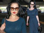 25.MARCH.2015 - LOS ANGELES - USA\nDITA VON TEESE MAKES HER WAY THROUGH LOS ANGELES INTERNATIONAL AIRPORT ( LAX ) AFTER ARRIVING ON AN INCOMING FLIGHT TO LOS ANGELES. THE BURLESQUE DANCER, MODEL, COSTUME DESIGNER, ENTREPRENEUR AND OCCASIONAL ACTRESS HURRIED PAST THE AUTOGRAPH SEEKERS AND PHOTOGRAPHERS TO HER RIDE, WEARING RED LIPPY, A FLOWING BLUE DRESS AND BLACK PUMPS.\nBYLINE MUST READ : XPOSUREPHOTOS.COM\n*AVAILABLE FOR UK SALE ONLY*\n***UK CLIENTS - PICTURES CONTAINING CHILDREN PLEASE PIXELATE FACE PRIOR TO PUBLICATION ***\n*UK CLIENTS MUST CALL PRIOR TO TV OR ONLINE USAGE PLEASE TELEPHONE 0208 344 2007*