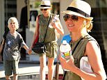 Brentwood, CA - Naomi Watts leads her boys Samuel and Alexander to karate class Wednesday afternoon in Brentwood.  The mother-of-two dressed for the warm weather in an olive green pocket romper with a pair of sandals, sunglasses and straw fedora.\nAKM-GSI           March 25, 2015\nTo License These Photos, Please Contact :\n \n Steve Ginsburg\n (310) 505-8447\n (323) 423-9397\n steve@akmgsi.com\n sales@akmgsi.com\n \n or\n \n Maria Buda\n (917) 242-1505\n mbuda@akmgsi.com\n ginsburgspalyinc@gmail.com