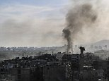 DAMASCUS, SYRIA - MARCH 25: Smoke rises in the opposition-controlled district of Jobar, in eastern Damascus following the airstrikes of Syrian regime forces on March 25, 2015. (Photo by Ammar Sulaiman/Anadolu Agency/Getty Images)