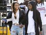 EXCLUSIVE: ** PREMIUM RATES APPLY ** Christina Milian and Lil Wayne hold hands appearing to confirm their 'special' relationship Ö While Wheezy's bodyguard smiles on.  The pair were pictured leaving a film set together hand-in-hand in Hollywood.   Pictured: Christina Milian, Lil Wayne Ref: SPL983397  250315   EXCLUSIVE Picture by: Deano / Splash News  Splash News and Pictures Los Angeles: 310-821-2666 New York: 212-619-2666 London: 870-934-2666 photodesk@splashnews.com