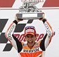 Moto GP race winner Marc Marquez of Spain  lifts the trophy as  2nd placed Moto GP rider Valentino Rossi of Italy applauds during the Valencia Motorcycle Grand Prix, the last race of the season, at the Ricardo Tormo circuit in Cheste near Valencia, Spain, Sunday Nov. 9, 2014. (AP Photo/Alberto Saiz)