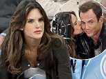 2015 RAMEY PHOTO 310-828-3445 March 25th, 2015 - New York City Actor, Will Arnett, along with Alessandra Ambrosio film TMNT 2 at a Knick game in NYC. SPORTNY