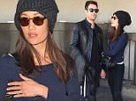 26.MARCH.2015 - LOS ANGELES - USA\nACTRESS MAGGIE Q SHOWS OFF HUGE ENGAGEMENT RING WITH FIANCEE DYLAN MCDERMOTT AT LAX. THE HAPPY COUPLE PATIENTLY WAITED FOR THEIR LIMO AND SEEMED TO BE IN A CHIPPER MOOD.\nBYLINE MUST READ : XPOSUREPHOTOS.COM\n*AVAILABLE FOR UK SALE ONLY*\n***UK CLIENTS - PICTURES CONTAINING CHILDREN PLEASE PIXELATE FACE PRIOR TO PUBLICATION ***\n*UK CLIENTS MUST CALL PRIOR TO TV OR ONLINE USAGE PLEASE TELEPHONE 0208 344 2007*
