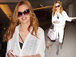"UK CLIENTS MUST CREDIT: AKM-GSI ONLY EXCLUSIVE: Bella Thorne arrives at LAX in Los Angeles, CA on an incoming flight from New York with her little furry four legged friend on March 25, 2015. Bella and her new flame Brandon Lee turned up the heat on their adorable night out together on March 21 as 'The DUFF' star enjoyed a romantic dinner with Pamela Anderson's son at Nobu in West Hollywood, CA. ""They were way into each other,"" an eyewitness at Nobu added.  Pictured: Bella Thorne Ref: SPL984618  250315   EXCLUSIVE Picture by: AKM-GSI / Splash News"