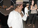 "Picture Shows: Justin Bieber  March 27, 2015    Freshly roasted pop star Justin Bieber enjoys a night out on the town in Los Angeles, California. The Biebs is always finding ways to show his fans how much he loves them and tonight was no exception. Justin graciously (and perhaps accidentally, jury's out on that) stepped on the bare foot of a female smoker out front of an establishment. While the moment may have been painful, she can at least take solace in the fact she'll always have the story to tell of ""that one night in LA when Justin Bieber like totally stepped on my foot, you guys! I can't even!"".    Non-Exclusive  UK Rights Only    Pictures by : FameFlynet UK    2015  Tel : +44 (0)20 3551 5049  Email : info@fameflynet.uk.com"