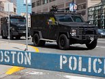 BOSTON - 04/16/13 - A Boston Police S.W.A.T. van parked on the corner of Huntington Avenue and Ring Road, located near the twin explosions at the Boston Marathon the day before. A poster for the Boston Marathon can still be seen on the right side. PHOTO: ALEXANDRE ISOBE/NURPHOTO