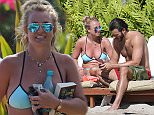 EXCLUSIVE:  A bikini clad Britney Spears enjoys a day by the pool in Hawaii and is wearing what looks like engagement ring.