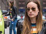 New York, NY - Actress, Olivia Wilde, feeling particularly colorful in NYC when she was spotted in a multi-color sweater with stripes.  She was seen graciously hoping out of a cab and strutting her stuff down the sidewalk.  She was wearing a black biker jacket, multi-color sweater, blue jeans, and brown suede booties.\nAKM-GSI         March 27, 2015\nTo License These Photos, Please Contact :\nSteve Ginsburg\n(310) 505-8447\n(323) 423-9397\nsteve@akmgsi.com\nsales@akmgsi.com\nor\nMaria Buda\n(917) 242-1505\nmbuda@akmgsi.com\nginsburgspalyinc@gmail.com