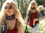 """Birthday girl Fergie spends her day with the greatest gift she could ask for, her son Axl, at a park in Brentwood, California. Fergie turned 40 today, though she already celebrated with an intimate """"Old Hollywood"""" themed costume party last Saturday night."""