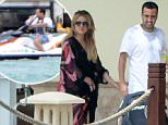 ***MAIL ONLINE USE ONLY***\nEXCLUSIVE TO INF.  \nMarch 28, 2015: On-again couple Khloe Kardashian and French Montana show some PDA on Diddy's dock before the rapper goes for a jetski ride with a friend. Montana clearly didn't want the party to stop for even a few minutes as he was seen jumping onto one of Diddy's jetskis with a bottle of Ciroc Vodka, and took a few swigs while steering the vessel with one hand.\nMandatory Credit: INFphoto.com Ref: infusmi-11/13