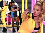 INGLEWOOD, CA - MARCH 28:  Rapper Iggy Azalea performs onstage during Nickelodeon's 28th Annual Kids' Choice Awards held at The Forum on March 28, 2015 in Inglewood, California.  (Photo by Kevin Winter/Getty Images)