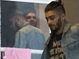 """Picture Shows: Naughty Boy, Zayn Malik  March 29, 2015\n \n **MAIL ONLINE USE ONLY.**\n \n The first pictures of Zayn Malik with hit record producer Naughty Boy since leaving boy band """"One Direction"""" at a recording studio at Ealing Studios in London, UK.\n \n Zayn, who recently left supergroup """"One Direction"""" after abandoning their Asia tour, looks like he's wasting no time recording his first solo album. \n \n It has been reported that Zayn's solo music will have a 'Slowed down sexual vibe' that will blow your mind. \n \n Zayn wore a t-shirt with a 'WHY THE FUCK NOT' print as he chatted to Naughty Boy in the corridor of the studio.\n \n **MAIL ONLINE USE ONLY.**\n \n Exclusive\n WORLDWIDE RIGHTS\n \n Pictures by : FameFlynet UK © 2015\n Tel : +44 (0)20 3551 5049\n Email : info@fameflynet.uk.com"""