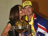 MELBOURNE, AUSTRALIA - MARCH 29:  Michael Clarke of Australia and his wife Kyly Clarke pose with the trophy in the change rooms during the 2015 ICC Cricket World Cup final match between Australia and New Zealand at Melbourne Cricket Ground on March 29, 2015 in Melbourne, Australia.  (Photo by Ryan Pierse/Getty Images)