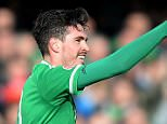Northern Ireland's Kyle Lafferty celebrates scoring against Finland during the Euro 2016 qualifier soccer match at Windsor Park, Belfast, Sunday March 29, 2015. (AP Photo/PA, Martin Rickett) UNITED KINGDOM OUT  NO SALES  NO ARCHIVE