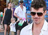 Picture Shows: April Love Geary, Julian Thicke, Robin Thicke  March 28, 2015\n \n Singer Robin Thicke and his new girlfriend take his son Julian grocery shopping at Bristol Farms in West Hollywood, California. Robin recently sold his Hollywood Hills home for more then 1.9 million that he paid for it. \n \n Non Exclusive\n UK RIGHTS ONLY\n \n Pictures by : FameFlynet UK © 2015\n Tel : +44 (0)20 3551 5049\n Email : info@fameflynet.uk.com