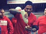 Daniel Alves handing out food