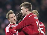 Denmark's Nicklas Bendtner (C) celebrates with teammates after scoring during the friendly football match Denmark vs USA in Aarhus, Denmark on March 25, 2015. AFP PHOTO / SCANPIX DENMARK / CLAUS FISKER   +++ DENMARK OUT +++CLAUS FISKER/AFP/Getty Images