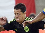 LOS ANGELES, CA - MARCH 28: Javier Hernandez #14 of Mexico drives the ball against Antonio Valencia #16 of Ecuador during the International Friendly match between Mexico and Ecuador at the Los Angeles Coliseum March 28, 2015, in Los Angeles, California. (Photo by Kevork Djansezian/Getty Images)