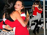 Cara Delevingne picks up Kendall Jenner when greeting her along with Gigi Hadid, Katy Perry and Dakota Fanning at Chanel's 'Cruise wit Karl Lagerfeld' in NYC.  Pictured: Cara Delevingne and Kendall Jenner Ref: SPL988547  310315   Picture by: XactpiX/Splash News  Splash News and Pictures Los Angeles: 310-821-2666 New York: 212-619-2666 London: 870-934-2666 photodesk@splashnews.com