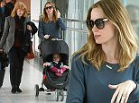 ***MANDATORY BYLINE TO READ INFPhoto.com ONLY***\nEmily Blunt and daughter Hazel Krasinski arrive at London's Heathrow Airport.\n\nPictured: Emily Blunt, Hazel Krasinski\nRef: SPL987886  300315  \nPicture by: INFphoto.com\n\n