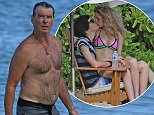 EXCLUSIVE: A shirtless Pierce Brosnan stays in shape by swimming while in Hawaii.  Pictured: Pierce Brosnan Ref: SPL985438  290315   EXCLUSIVE Picture by: Splash News  Splash News and Pictures Los Angeles: 310-821-2666 New York: 212-619-2666 London: 870-934-2666 photodesk@splashnews.com