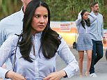 UK CLIENTS MUST CREDIT: AKM-GSI ONLY EXCLUSIVE: Actress Olivia Munn and Green Bay Packers quarterback Aaron Rodgers arrive for dinner at Pace in West Hollywood, CA on March 27, 2015. Olivia made some final touches to her skirt and hair as she and her beau made their way inside of the popular eatery for a bite on date night.  Pictured: Olivia Munn and Aaron Rodgers Ref: SPL986997  270315   EXCLUSIVE Picture by: AKM-GSI / Splash News