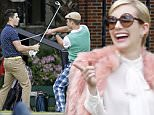 134922, EXCLUSIVE: Emma Roberts looks on as Nick Jonas and Glen Powell fight with golf clubs in a scene for their new series 'Scream Queens' in New Orleans. The stars were full of smiles and seemed to be having a good time as they filmed golfing scenes at a local university before Nick and Glen broke into a mock sword fight with their clubs. New Orleans, Louisiana - Monday March 30, 2015. Photograph: © PacificCoastNews. Los Angeles Office: +1 310.822.0419 sales@pacificcoastnews.com FEE MUST BE AGREED PRIOR TO USAGE