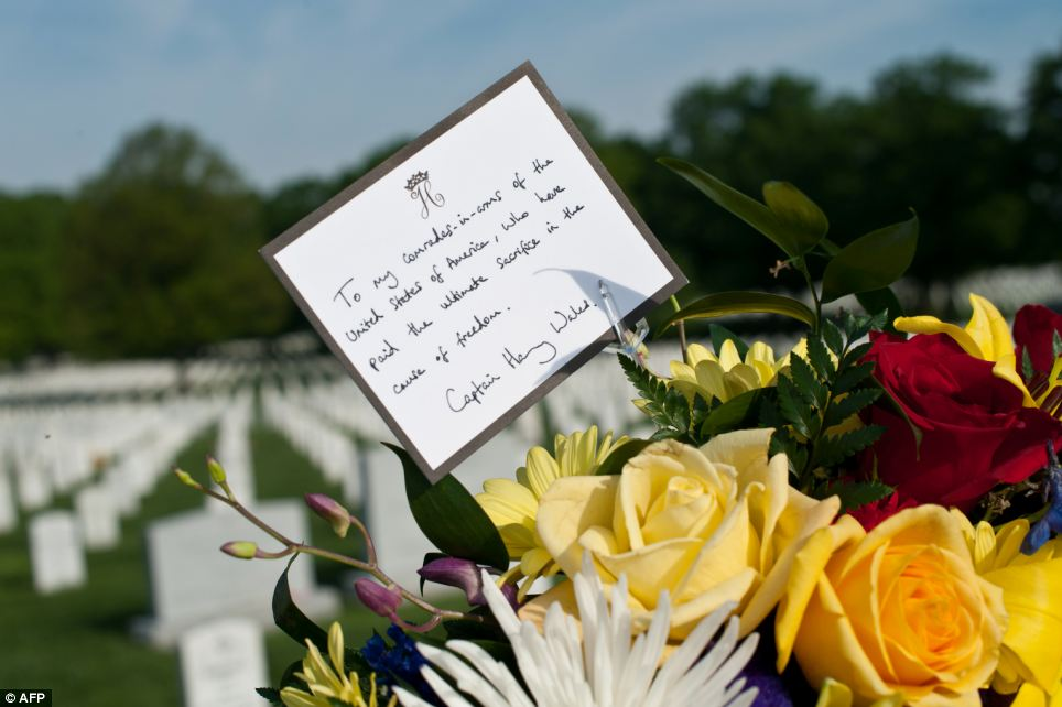 Touching: A card from Prince Harry is part of a wreath that the Prince will place at Section 60 of Arlington National Cemetery, where veterans of the wars in Iraq and Afghanistan are buried