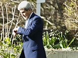 U.S. Secretary of State John Kerry (R) checks his watch outside the Beau Rivage Palace Hotel in a break during Iran nuclear program talks in Lausanne April 1, 2015. Six world powers and Iran meet again on Wednesday in a bid to reach a preliminary accord on reining in Tehran's nuclear programme, after failing to agree crucial details such as the lifting of U.N. sanctions by a midnight deadline. REUTERS/Ruben Sprich