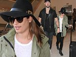 """Lea Michele & her boyfriend, Matthew Paetz are all smiles as the cte couple arrive in Los Angeles holding hands!  The adorable """"Glee"""" star wore an army green jacket, with a black hat & pants with boots while her hunky boyfriend showed off his chest tattoo in a black tank top & vest.\n\nPictured: Lea Michele, Matthew Paetz\nRef: SPL989706  010415  \nPicture by: Splash News\n\nSplash News and Pictures\nLos Angeles: 310-821-2666\nNew York: 212-619-2666\nLondon: 870-934-2666\nphotodesk@splashnews.com\n"""