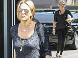 UK CLIENTS MUST CREDIT: AKM-GSI ONLY\nEXCLUSIVE: Actress Molly Sims is spotted leaving medical building with a hospital wristband just a week after giving birth to her daughter, Scarlett May Stuber. She appeared to be already slim in a gray top, black leggings, and animal print flats.\n\nPictured: Molly Sims\nRef: SPL989295  310315   EXCLUSIVE\nPicture by: AKM-GSI / Splash News\n\n
