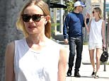UK CLIENTS MUST CREDIT: AKM-GSI ONLY EXCLUSIVE: Kate Bosworth walks hand in hand with husband Michael Polish as the pair head to lunch in the city in West Hollywood.  Kate and Michael shared a loving moment, gazing in each other's eyes and then later sharing a laugh after spotting a camera.  Kate is looking spring ready in all white and carrying a Ralph Lauren Small Ricky Drawstring bag.  Pictured: Kate Bosworth and Michael Polish Ref: SPL989013  310315   EXCLUSIVE Picture by: AKM-GSI / Splash News