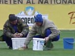 - Romania fans complained the country had been made to look stupid after two men armed with meagre car sponges battled hopelessly to soak up water from a rain-drenched pitch ahead of their Euro 2016 qualifier against the Faroe Islands. Footage of the groundsmen desperately sponging the surface and squeezing minimal amounts of water into buckets ahead of Sunday's match caused a stir with fans taking to social media to label organisers a laughing stock. The game, which Romania won 1-0, took place but only after a an interior ministry helicopter was drafted in to hover over the centre of the pitch in an effort to disperse surface water at the Ilie Oana stadium in Ploiesti.