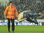 The man was apprehended by stewards and led away on Monday night