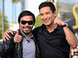 """UNIVERSAL CITY, CA - APRIL 01:  Manny Pacquiao (L) and Mario Lopez visit """"Extra"""" at Universal Studios Hollywood on April 1, 2015 in Universal City, California.  (Photo by Noel Vasquez/Getty Images)"""
