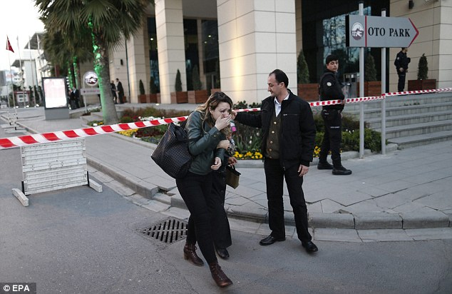 People react to the shooting of an armed woman in Istanbul. She was carrying a rifle, two hand grenades and one pistol