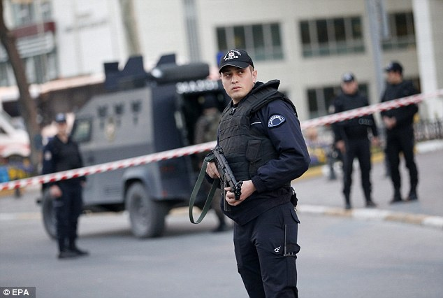 Armed: The woman was carrying a rifle, two hand grenades and one pistol, it said. Local media said a man had also been detained