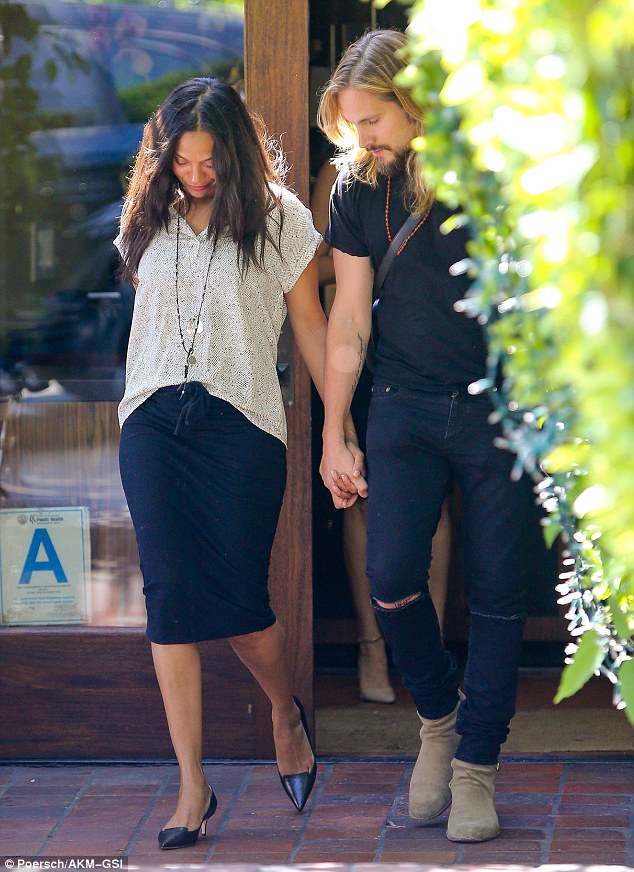 Loved up: Zoe Saldana and her husband Marco Perego clasped hands tightly during their lunch date in West Hollywood on Wednesday, looking happily in love