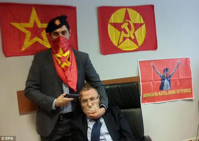 Threat: The Revolutionary People's Liberation Party-Front published disturbing photographs of the terrified prosecutor with a gun to his head on their official Facebook page before he was shot