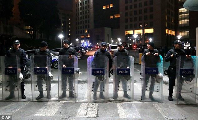 Standing guard:Members of security forces stand outside the main courthouse in Istanbul during the siege