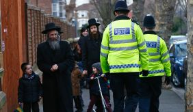 Members of the Jewish community collect their children from school in north London