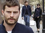LONDON, ENGLAND - APRIL 01:  (EXCLUSIVE COVERAGE) (MINIMUM ONLINE/WEB USAGE FEE   150 FOR THE SET) 'Fifty shades of Grey' Actor Jamie Dornan pictured out shopping with his wife Amelia Warner on April 1, 2015 in London, England.  (Photo by Crowder/Legge/GC Images)