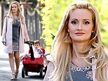 **EXCLUSIVE** Credit: MOVI Inc.  Date March 27th 2015\\nA week after revealing that she was almost suicidal while living at the Playboy mansion with Hugh Hefner, Holly Madison looks chic and happy for a morning stroll near her home in Las Vegas,NV pulling along her adorable daughter Rianbow in a bright red wagon.